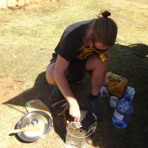 Sebastian making a banana-cranberry-porridge using the Save80 stove - yammie!