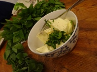 Making herb butter (plant in the background: goutweed aka ground elder)